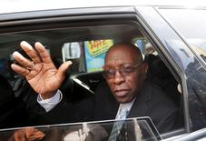 Former FIFA vice-president Jack Warner waves from a car after leaving a court where he is fighting against extradition to the U.S. for corruption charges, in Port-of-Spain, Trinidad, July 9, 2015.  REUTERS/Andrea De Silva