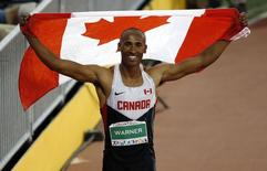 Jul 23, 2015; Toronto, Ontario, CAN; Damian Warner of Canada celibates winning the men's athletics decathlon during the 2015 Pan Am Games at CIBC Pan Am Athletics Stadium. Mandatory Credit: Erich Schlegel-USA TODAY Sports