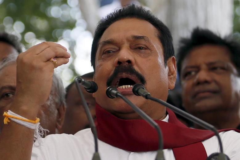 Former Sri Lankan president Mahinda Rajapaksa speaks to his supporters at his residence in Medamulana July 1, 2015. REUTERS/Dinuka Liyanawatte/Files