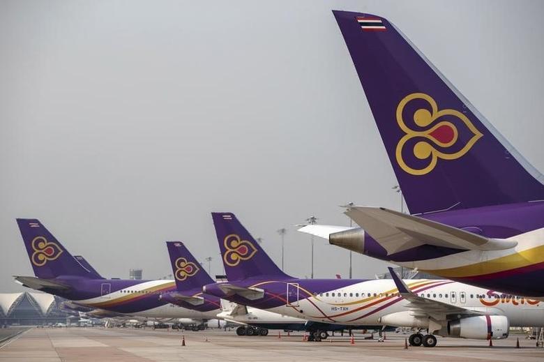 Thai Airways aircraft are parked on the tarmac at Bangkok's Suvarnabhumi International Airport March 27, 2015. REUTERS/Athit Perawongmetha