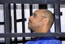 Саиф аль-Ислам Каддафи в камере в здании суда в Зинтане. 25 мая 2014 года. Суд Ливии во вторник заочно приговорил к смертной казни самого известного сына Муамара Каддафи, Саифа аль-Ислама, за подавление мирных протестов во время революции в 2011 году, положившей конец правлению его отца. REUTERS/Stringer
