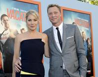 "Cast member Christina Applegate and husband musician Martyn LeNoble pose during the premiere of the film ""Vacation"" at the Regency Village Theatre in the Westwood section of Los Angeles, California July 27, 2015. REUTERS/Kevork Djansezian"