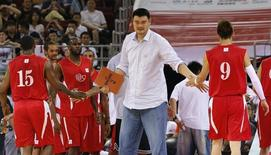 Retired Chinese and NBA basketball star Yao Ming encourages his NBA All-star team during a charity basketball match against the Chinese national team in Beijing July 1, 2013. REUTERS/Kim Kyung-Hoon