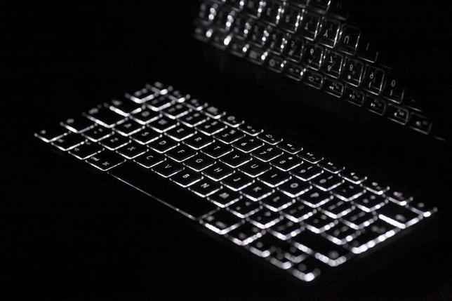 Backlit keyboard is reflected in screen of Apple Macbook Pro notebook computer in Warsaw February 6, 2012.  REUTERS/Kacper Pempel/Files (REPRESENTATIVE IMAGE)