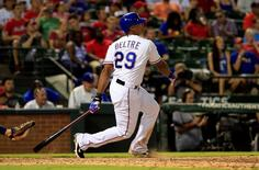 Aug 3, 2015; Arlington, TX, USA; Texas Rangers third baseman Adrian Beltre (29) hits a home run to complete the cycle during the fifth inning against the Houston Astros at Globe Life Park in Arlington. Mandatory Credit: Kevin Jairaj-USA TODAY Sports
