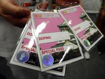 A volunteer with IAAF's local organizing committee displays the credential given to athletes who are selected for drug testing in the anti-doping offices at the 11th IAAF World Athletics Championships in Osaka August 24, 2007. REUTERS/Brian Snyder