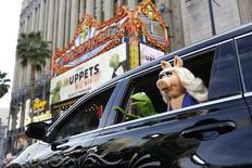 "The characters of Kermit and Miss Piggy arrive at the premiere of ""Muppets Most Wanted"" at El Capitan theatre in Hollywood, California March 11, 2014. REUTERS/Mario Anzuoni"