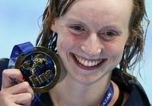 Katie Ledecky of the U.S. poses with her gold medal after the women's 1500m freestyle final at the Aquatics World Championships in Kazan, Russia, August 4, 2015.                      REUTERS/Stefan Wermuth