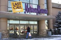 A customer walks by the Neiman Marcus Last Call store in Golden, Colorado January 23, 2014. REUTERS/Rick Wilking