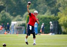 Jul 30, 2015; Foxborough, MA, USA; New England Patriots quarterback Tom Brady (12) throws during training camp at Gillette Stadium. Winslow Townson-USA TODAY Sports