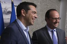 French President Francois Hollande (R) and Greek Prime Minister Alexis Tsipras meet on the occasion of  the inauguration of a new Suez Canal waterway, in Ismailia, Egypt, August 6, 2015. REUTERS/Philippe Wojazer
