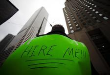 A man, with a sign strapped to his back, uses a megaphone to attract the attention of potential employers  in Toronto, March 5, 2009.      REUTERS/Mark Blinch