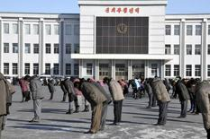 North Korean bow as they pay respects to mark the third anniversary of the death of former leader Kim Jong Il in this undated photo released December 17, 2014 by North Korea's Korean Central News Agency (KCNA), in Pyongyang. REUTERS/KCNA