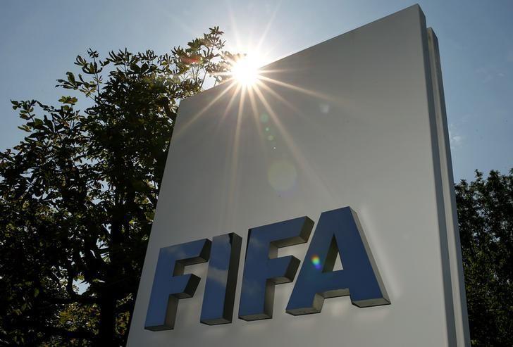 The logo of FIFA is seen in front of its headquarters in Zurich, Switzerland July 20, 2015. REUTERS/Arnd Wiegmann