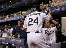 Aug 7, 2015; St. Petersburg, FL, USA; Tampa Bay Rays left fielder Grady Sizemore (24) is congratulated by shortstop Asdrubal Cabrera (13) after he hit a home run during the fourth inning against the New York Mets at Tropicana Field. Kim Klement-USA TODAY Sports