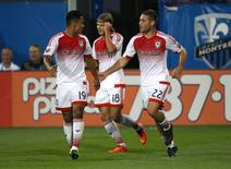 Aug 8, 2015; Montreal, Quebec, CAN; D.C. United forward Chris Rolfe (18) celebrates his goal against Montreal Impact with teammates forward Jairo Arrieta (19) and defender Chris Korb (22) during the first half at Stade Saputo. Jean-Yves Ahern-USA TODAY Sports