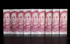 Chinese 100 yuan banknotes are seen in this picture illustration taken in Beijing in this July 11, 2013 file photo. REUTERS/Jason Lee/Files