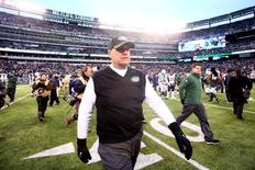 Dec 21, 2014; East Rutherford, NJ, USA; New York Jets head coach Rex Ryan walks off the field after losing to the New England Patriots at MetLife Stadium. The Patriots defeated the Jets 17-16. Mandatory Credit: Brad Penner-USA TODAY Sports -