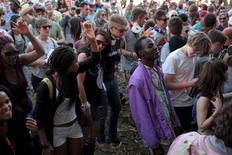 Revellers dance at the Oppikoppi music festival August 7, 2015. REUTERS/Stringer