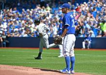 Aug 15, 2015; Toronto, Ontario, CAN;  Toronto Blue Jays starting pitcher Marco Estrada (25) watches New York Yankees right fielder Carlos Beltran (36) round the bases after hitting a home run in the first inning at  Rogers Centre. Dan Hamilton-USA TODAY Sports