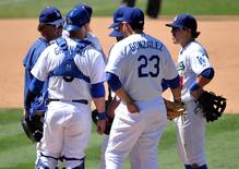 August 16, 2015; Los Angeles, CA, USA; Los Angeles Dodgers manager Don Mattingly (8) speaks with starting pitcher Zack Greinke (21) and infielders during the seventh inning against the Cincinnati Reds  at Dodger Stadium. Mandatory Credit: Gary A. Vasquez-USA TODAY Sports