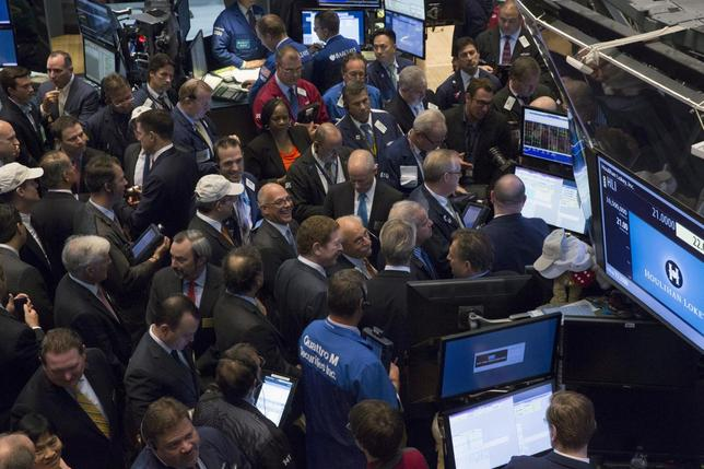 Traders, company executives and guests gather for the IPO of Houlihan Lokey, Inc., on the floor of the New York Stock Exchange August 13, 2015.  REUTERS/Brendan McDermid