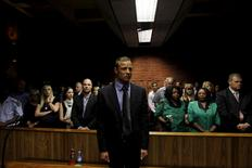 """Blade Runner"" Oscar Pistorius awaits the start of court proceedings in the Pretoria Magistrates court in this February 19, 2013 file photo.  REUTERS/Siphiwe Sibeko/Files"