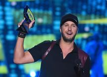 "Luke Bryan accepts the award for male video of the year for ""Play It Again"" during the 2015 CMT Awards in Nashville, Tennessee June 10, 2015. REUTERS/Harrison McClary"