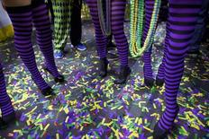 The legs of cheerleaders supporting contestants are seen as they stand among confetti, while they wait for their turn during a parade at the Wells Fargo Center before the 23rd annual Wing Bowl in Philadelphia, Pennsylvania January 30, 2015. REUTERS/Mark Makela