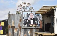 A poster is pictured at 'Dismaland', a theme park-styled art installation by British artist Banksy, at Weston-Super-Mare in southwest England, Britain, August 20, 2015. REUTERS/Toby Melville