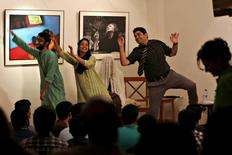 Stand-up comedian Shehzad Ghias Shaikh (R) along with his troupe performs during a show at The Second Floor (T2F) a community space for open dialogue, in Karachi, Pakistan, August 16, 2015. REUTERS/Akhtar Soomro
