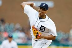 Aug 20, 2015; Detroit, MI, USA; Detroit Tigers starting pitcher Alfredo Simon (31) pitches in the first inning against the Texas Rangers at Comerica Park. Rick Osentoski-USA TODAY Sports
