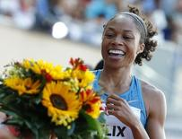 Allyson Felix of the U.S. celebrates victory in the 200 metres women event at the IAAF Diamond League Athletissima athletics meeting at the Pontaise Stadium in Lausanne, Switzerland, July 9, 2015. REUTERS/Pierre Albouy