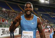 Justin Gatlin from the U.S. celebrates after winning the men's 100 meters event during the Golden Gala IAAF Diamond League at the Olympic stadium in Rome, Italy June 4, 2015. REUTERS/Giampiero Sposito