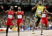 Justin Gatlin and Tyson Gay from the U.S. and Usain Bolt (L-R) of Jamaica compete in the men's 100m final during the 15th IAAF World Championships at the National Stadium in Beijing, China August 23, 2015.  REUTERS/Lucy Nicholson