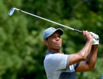 Aug 22, 2015; Greensboro, NC, USA; Tiger Woods hits his tee shot on the 3rd hole during the third round of the Wyndham Championship golf tournament at Sedgefield Country Club.   Rob Kinnan-USA TODAY Sports
