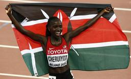 Vivian Jepkemoi Cheruiyot of Kenya celebrates winning the women's 10,000 metres final during the 15th IAAF World Championships at the National Stadium in Beijing, China August 24, 2015. REUTERS/David Gray