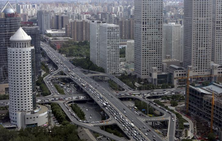 Vehicles drive on the Guomao Bridge through Beijing's central business district, June 11, 2015. REUTERS/Jason Lee