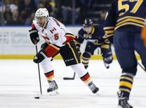 Calgary Flames defenseman Mark Giordano (5) brings the puck into the Buffalo Sabres zone during the first period at First Niagara Center. Mandatory Credit: Kevin Hoffman-USA TODAY Sports