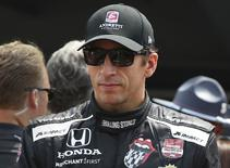 IndyCar Series driver driver Justin Wilson is introduced before the 2015 Indianapolis 500 at Indianapolis Motor  Speedway in Indianapolis, Indiana, in this file photo taken May 24, 2015. Mark J. Rebilas-USA TODAY Sports
