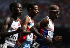 (L-R) Ali Kaya of Turkey, Aron Kifle of Eritrea and Mo Farah of Britain compete in their men's 5000 metres heat at the IAAF World Championships at the National Stadium in Beijing, China August 26, 2015. REUTERS/Lucy Nicholson