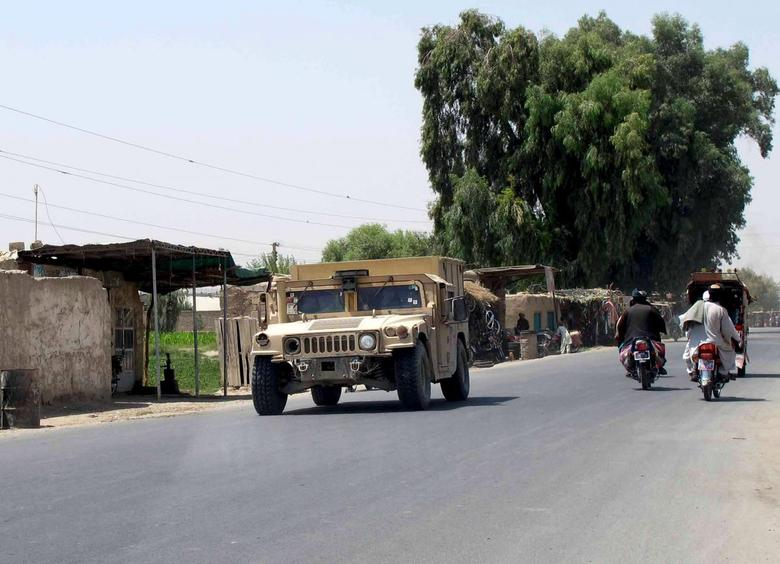 An Afghan National Police armored vehicle patrols on a street in Lashkar Gah capital of Helmand province, Afghanistan August 26, 2015. REUTERS/ Stringer