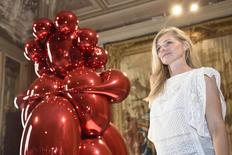 "Beatrice Trussardi, president of the Nicola Trussardi Foundation, a non-profit cultural organisation that co-produced the show, poses next an art piece titled ""Balloon Venus"" by artist Jeff Koons during a news conference for ""La Grande Madre'"" (The Great Mother) exhibition at Palazzo Reale in Milan, Italy, August 25, 2015. REUTERS/Flavio Lo Scalzo"