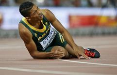 Wayde Van Niekerk of South Africa fades after winning the men's 400m final during the 15th IAAF World Championships at the National Stadium in Beijing, China August 26, 2015.  REUTERS/Lucy Nicholson