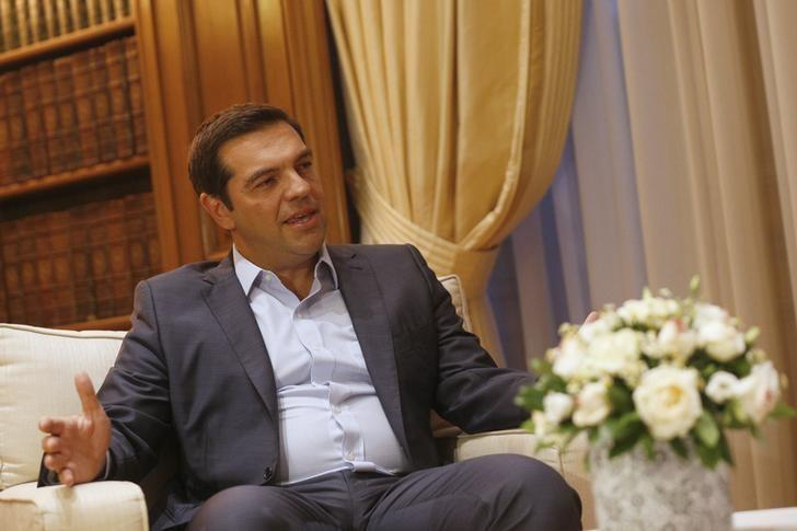 Outgoing Greek Prime Minister Alexis Tsipras speaks with Greece's Supreme top Court judge Vassiliki Thanou (not pictured) after her swearing in ceremony as the country's caretaker Prime Minister, at the handover ceremony at the prime minister's office at Maximos Mansion in Athens, Greece August 27, 2015. REUTERS/Stoyan Nenov