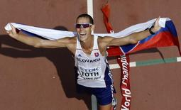 Matej Toth of Slovakia celebrates winning the men's 50 km race walk final during the 15th IAAF World Championships at the National Stadium in Beijing, China August 29, 2015. REUTERS/Fabrizio Bensch
