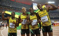 Jamaica's team (L-R) Nesta Carter, Asafa Powell, Nickel Ashmeade and Usain Bolt pose for photographers after winning the men's 4 x 100 metres relay final during the 15th IAAF World Championships at the National Stadium in Beijing, China, August 29, 2015.           REUTERS/Kai Pfaffenbach