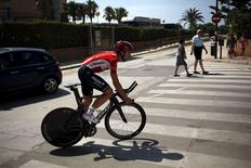 Lotto-Soudal rider Kris Boeckmans of Belgium rides during a team training session on the eve of La Vuelta cycling race, in Malaga, southern Spain, August 21, 2015.  REUTERS/Jon Nazca