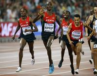 Kenya's Asbel Kiprop (C) celebrates as he crosses the finish line to win the men's 1500 metres final during the 15th IAAF World Championships at the National Stadium in Beijing, China August 30, 2015. REUTERS/Damir Sagolj