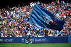 Aug 30, 2015; Toronto, Ontario, CAN; Toronto Blue Jays mascot Ace waves the Blue Jays flag before eighth inning against Detroit Tigers  at Rogers Centre. Mandatory Credit: Peter Llewellyn-USA TODAY Sports